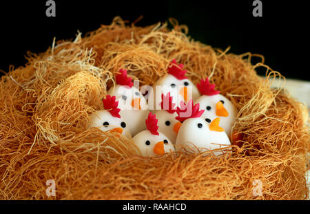 Easter chicken nest marzipan art - Stock Photo