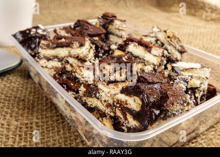 Chocolate brownies with coffee on a rug background. - Stock Photo
