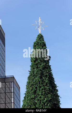 Tall artificial outdoor Christmas tree in downtown Vancouver, BC, Cabada - Stock Photo