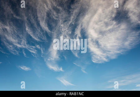 Wispy clouds against a blue sky - Stock Photo