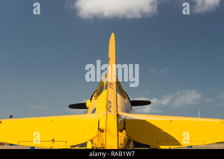Yellow Harvard, fighter plane, against sky - Stock Photo