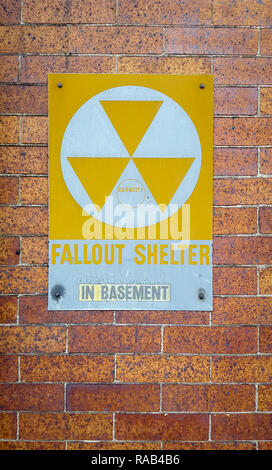 Fallout shelter in basement sign, vintage, on a brick wall - Stock Photo