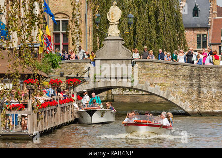 boat ride on the canals in Bruges, Belgium - Stock Photo
