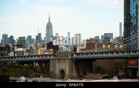 Close-up view of the Manhattan bridge and a beautiful skyline seen from a narrow alley in Manhattan, New York City, USA. - Stock Photo