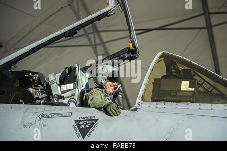 Capt. Thomas Ainscough, 74th Fighter Squadron A-10C Thunderbolt II pilot, laughs while waiting to taxi to the flightline, Jan. 12, 2017, at Moody Air Force Base, Ga. Ainscough and other Airmen and aircraft from the 74th FS were preparing to depart for a two-week long exercise at Nellis Air Force Base in Las Vegas, Nev. - Stock Photo