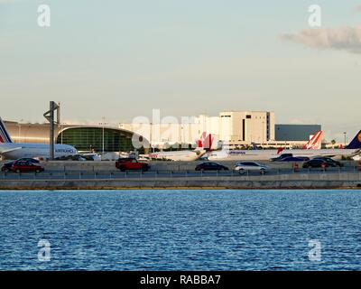 Several jumbo, international planes - Air France, Swiss, Lufthansa, Virgin Air -  parked at the Miami International Airport, Miami, Florida, USA. - Stock Photo