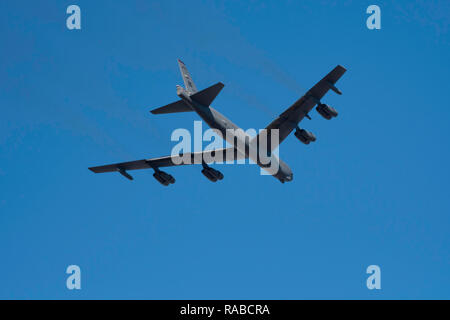 BOSSIER CITY, LOUISIANA, U.S.A.- DEC. 4, 2018: A U.S. Air Force B-52 bomber from Barksdale Air Force Base flies over the city. - Stock Photo