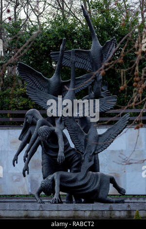 An image of the sculpture of the Children of Lir in the Garden of Remembrance (An Gairdín Cuimhneacháin) in Dublin City - Stock Photo