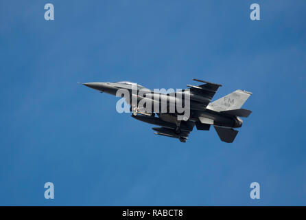 BOSSIER CITY, LA., U.S.A. - DEC. 17, 2018: A U.S. Air Force F-16 fighter flies over the city in its approach to Barksdale Air Force Base.