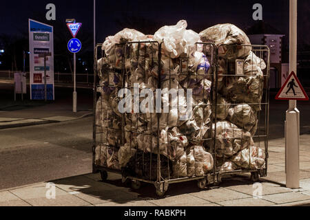Southport, Merseyside, UK. 3rd Jan, 2019. Bags of daily Retail Waste awaiting collection. Take-away coffee cups & plastic culinary items from commercial food premises bagged and awaiting collection at dawn in town centre retail park. Credit: MediaWorldImages/Alamy Live News - Stock Photo