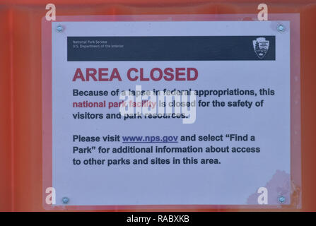 Assateaque, MD, December 29, 2018, USA: A sign at a closed rest room in the Assateaque Island National Park in Maryland explains why the facility is closed. The National Park service has closed most of the United States parks because the funding for the parks has run out due to the US Government shutdown. Patsy Lynch/MediaPunch - Stock Photo