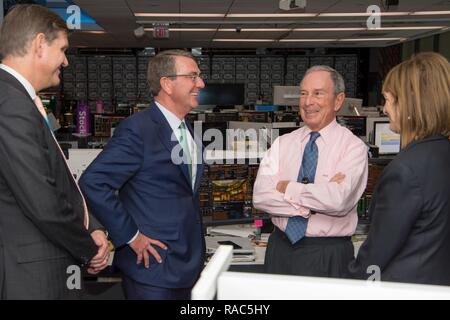 Secretary of Defense Ash Carter speaks with Mike Bloomberg, the founder and CEO of Bloomberg L.P., at the Bloomberg Television headquarters building in New York City on Jan. 12, 2017. - Stock Photo