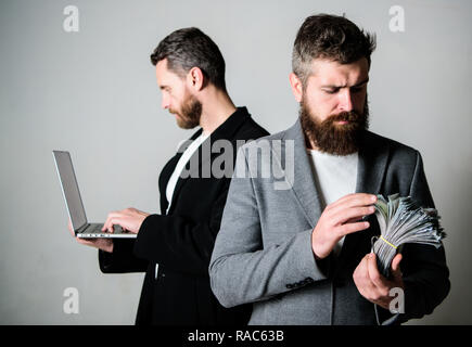 Developing applications. Digital technology. IT business. Online business. Earn money online business. They know how to make money. Team of web developer with laptop and sales manager with cash money. - Stock Photo