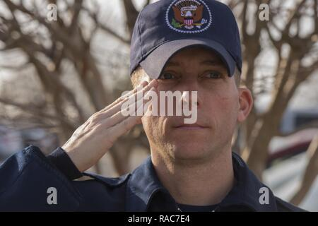 Tech. Sgt. Steven Conine, inaugural parade street cordon member, salutes at Joint Base Andrews, Md., Jan. 12, 2017. He and many other JBA members attended the cordon rehearsal, where they practiced marching, saluting, and standing at attention for the 58th Presidential Inaugural Parade. - Stock Photo