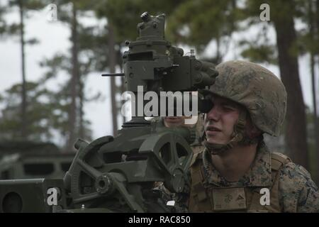 Lance Cpl Christopher Ploof Aims Down The Sight Of An M777A2 Towed 155mm Howitzer At Camp Lejeune NC Jan 18 2017 Is Attending Artillery