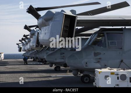 MV-22 Ospreys with the 24th Marine Expeditionary Unit set aboard USS Bataan (LHD 5) during Composite Unit Training Exercise Jan. 14, 2017. COMPTUEX is the MEU's final at-sea evaluation designed for Marines and Sailors to increase operational efficiency for deployment. - Stock Photo
