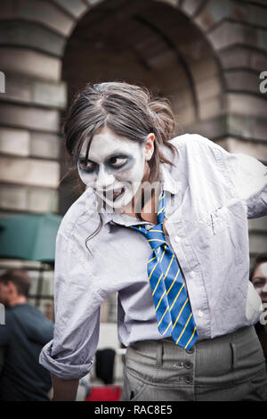 Edinburgh, Scotland - August 14, 2010: Female actresses promoting their outdoor show during the Fringe festival in Edinburgh. - Stock Photo