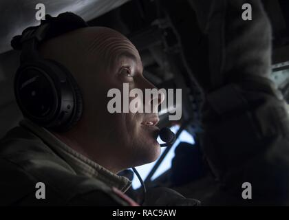 U.S. Air Force Master Sgt. Eric Jones, boom operator assigned to the 134th Air Refueling Wing, Tennessee Air National Guard, refuel 13th and 14th Fighter Squadron F-16 Fighting Falcon's over Northern Japan, Jan. 18, 2017. Boom operators refuel various types of aircraft in midair, extending the amount of time spent on training or combat missions. - Stock Photo