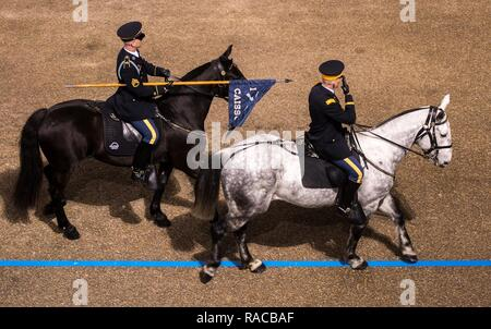 Soldiers with the 3rd U.S. Army Infantry Regiment's Caisson Platoon ride past the White House reviewing stand during the 58th Presidential Inaguration Parade in Washington, D.C., Jan. 20, 2017. More than 5,000 military members from across all branches of the armed forces of the United States, including Reserve and National Guard components, provided ceremonial support and Defense Support of Civil Authorities during the inaugural period. - Stock Photo
