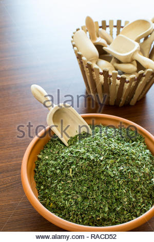 fine herbs in a ceramic bowl on the table, indian spices - Stock Photo