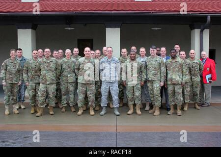 Approximately 30 members of the U.S. Army's Total Force – Active Duty, U.S. Army Reserve, and National Guard – pose for a picture, after meeting Jan. 18-19, at the Iowa National Guard's Camp Dodge Joint Maneuver Training Center in Johnston, Iowa, to take part in a Regional Total Army Conference. Officials discussed current issues and how they can help synchronize training efforts to produce stronger, better-trained Soldiers. Participants included Arkansas, Iowa, Kansas, Missouri, Nebraska, and Oklahoma National Guard officials, as well as representatives from U.S. Army Reserve units and Active - Stock Photo