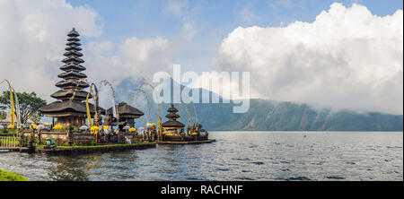 Pura Ulun Danu Bratan, Bali. Hindu temple surrounded by flowers on Bratan lake, Bali. Major Shivaite water temple in Bali, Indonesia. Hindu temple - Stock Photo