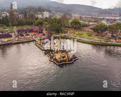 Photo from the drone. Aerial view of Pura Ulun Danu Bratan, Bali. Hindu temple surrounded by flowers on Bratan lake, Bali. Major Shivaite water temple in Bali, Indonesia. Hindu temple - Stock Photo