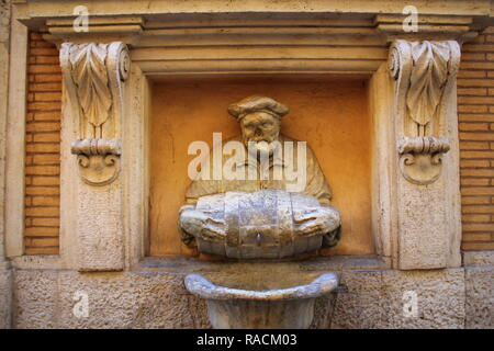 ROME, ITALY - December 28, 2018: Statue of an old man pouring water from a barrel used as a fountain nicknamed 'The Porter'. It was made in 1580 and used as a site to post satirical writings. - Stock Photo