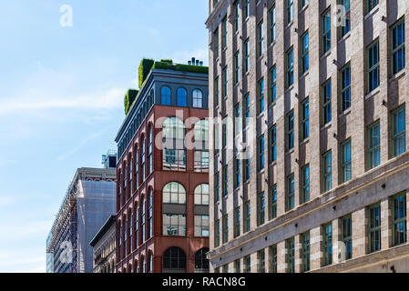 Low angle view of luxury apartment buildings in Tribeca North District of New York City - Stock Photo