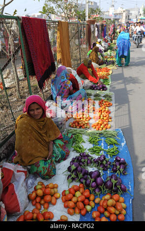 Women at village street market selling home grown vegetables laid out on sacking, Chhota Udepur, Gujarat, India, Asia - Stock Photo
