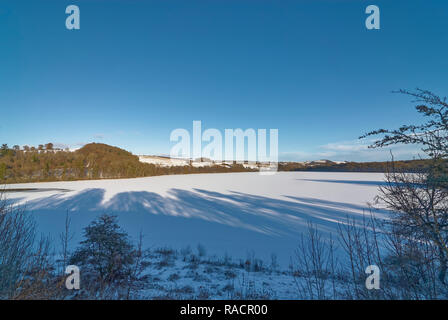 A frozen Loch Clunie on the outskirts of the Market Town of Blairgowrie, near the village of Forneth on one  Winters evening in January. - Stock Photo