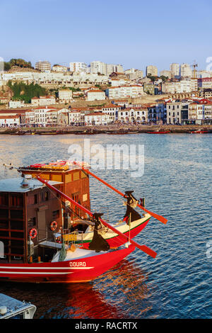 Evening view of tourist boats on the Douro River looking towards Vila Nova de Gaia and Porto wine shops, Porto, Portugal, Europe - Stock Photo