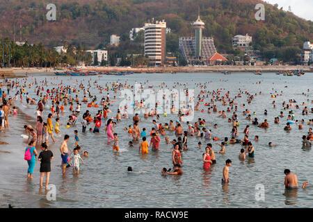 Sunday at the beach, Vietnamese families swimming in the South China Sea, Hang Dua Bay, Vung Tau, Vietnam, Indochina, Southeast Asia, Asia - Stock Photo