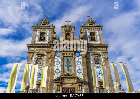 Facade of Igreja de Santo Ildefonso (Church of St. Ildelfonso) with azulejo blue and white painted ceramic tiles, Porto, Portugal, Europe - Stock Photo