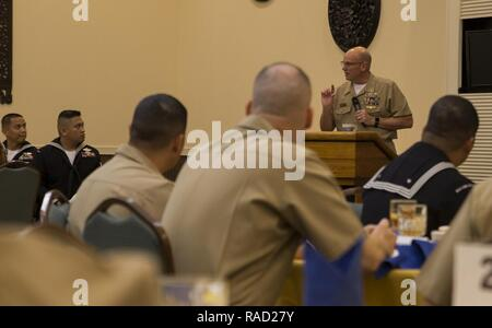 Navy Master Chief Petty Officer Michael J. Fasano speaks during a banquet at the Crow's Nest on Camp Shields, Okinawa, Japan, Jan. 26, 2017. The banquet honored the 2016 Blue Jacket, Junior and Senior Sailors of the Year for each U.S. Naval command on Okinawa. This was the first time all U.S. Naval commands on Okinawa held a collective Sailor of the Year ceremony. Fasano, from Mobile, Alabama, is the command master chief of III Marine Expeditionary Force. - Stock Photo