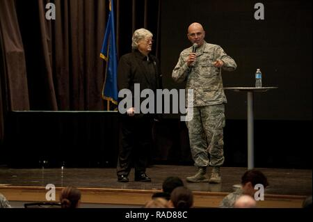 U.S. Air Force Chief Master Sgt. Alexander Del Valle, 51st Fighter Wing command chief, thanks Dave Roever, a Vietnam War veteran, for speaking about resiliency at Osan Air Base, Republic of Korea, Jan. 25, 2017. Roever, is an inspirational speaker who shares his story about how he survived after suffering burns all over his body when a phosphorus grenade exploded in his hand during the war. - Stock Photo
