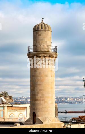 Minaret of the Mosque in the Shirvanshah Palace, Baku, Azerbaijan - Stock Photo
