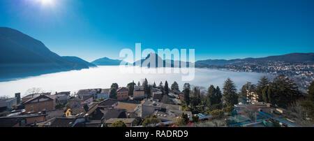 Thermal inversion on the Lugano Lake in Switzerland - Stock Photo