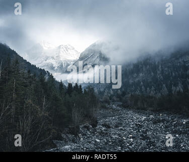 Clouds rising above the valley with a view on the Gspaltenhorn near the Oschinen Lake, Switzerland - Stock Photo