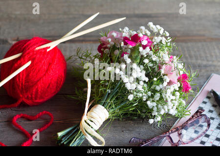 Grandparents day abstract concept with knitting  crossword and bouquet of flowers - Stock Photo