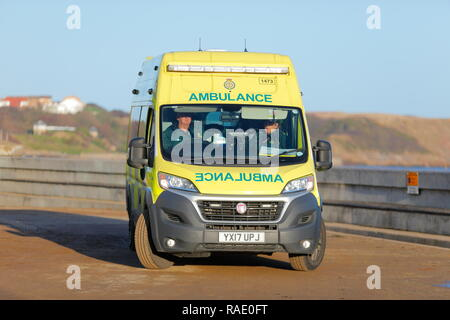 An NHS Fiat ambulance parked up in North Bay in Scarborough on New Years Day waiting for a call out. - Stock Photo