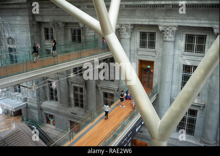 20.12.2018, Singapore, Republic of Singapore, Asia - The atrium of the National Gallery Singapore with link bridges of the old Supreme Court. - Stock Photo