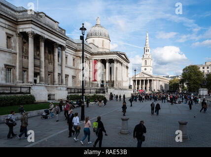 London, United Kingdom - October 18 2018:   The National Gallery and St Martins in the Field church viewed from Pall Mall heading into Trafalgar Squar - Stock Photo