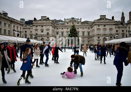 People skating on ice at the Somerset House Christmas Ice Rink. London, United Kingdom, December 2018. - Stock Photo