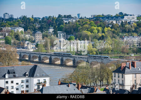 Properties in Tours (mid-west France): view of the northern district de the city and trams on the Wilson bridge, over the river Loire - Stock Photo