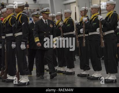 GREAT LAKES, Ill. (Dec. 14, 2018) Vice Chief of Naval Operations Adm. Bill Moran reviews the ceremonial honor guard during a pass-in-review graduation ceremony at Recruit Training Command. More than 30,000 recruits graduate annually from the Navy's only boot camp. - Stock Photo