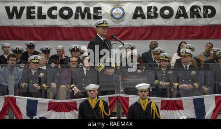 GREAT LAKES, Ill. (Dec. 14, 2018) Vice Chief of Naval Operations Adm. Bill Moran addresses the audience inside Midway Ceremonial Drill Hall during a pass-in-review graduation ceremony at Recruit Training Command. More than 30,000 recruits graduate annually from the Navy's only boot camp. - Stock Photo