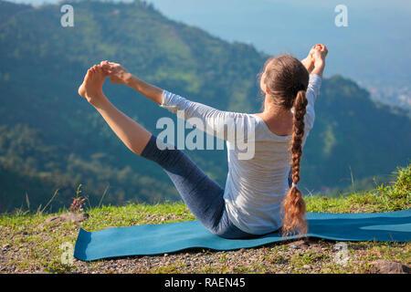 Yoga outdoors in mountains - Stock Photo