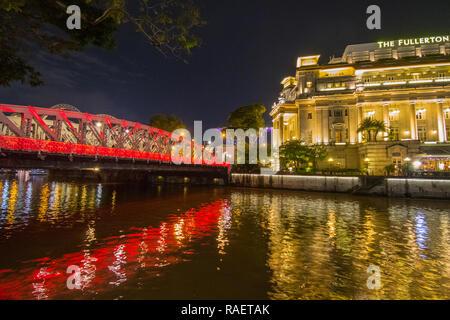 Fullerton Hotel at Anderson Bridge, Singapore - Stock Photo