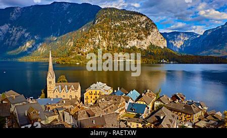 Panoramic scenic view in Austrian alps. Hallstatt mountain village at Hallstatt lake. Sunny day lake view from Hallstatt alps mountains. Location: res